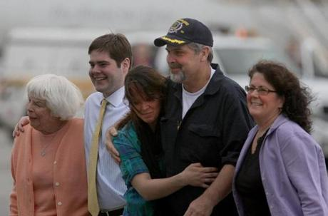 Captain Richard Phillips was greeted by family members after he arrived home following his ordeal in 2009.