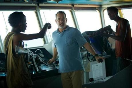 Tom Hanks played the title role of Captain Richard Phillips. The other actors in the movie included Barkhad Abdi (left) and Faysal Ahmed.