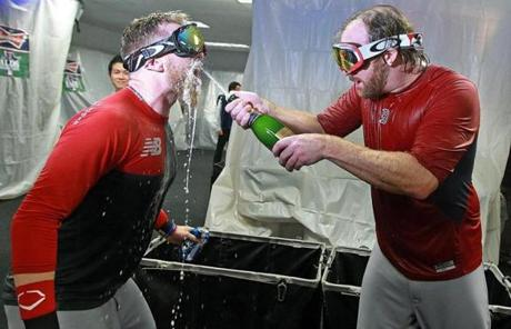 Mike Carp (left) was doused with champagne by Ryan Dempster.