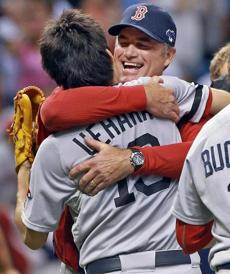 John Farrell hugged closer Koji Uehara after the win.