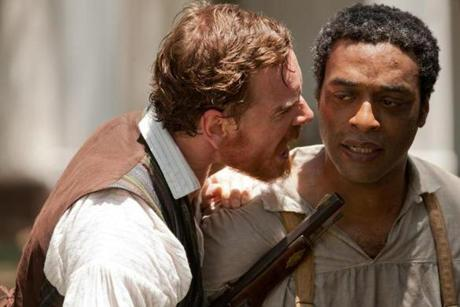Ejiofor, pictured with Michael Fassbender, stars in the real-life story of free man-turned-slave Solomon Northup.