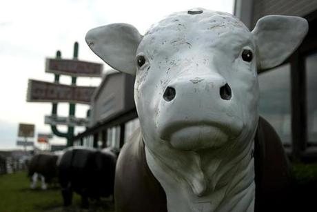 The Hilltop Steak House is a Route 1 landmark for its giant cactus and its herd of plastic cows.