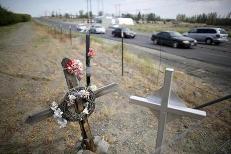 Crosses mark the spots where  people have been killed at the intersection of two major roads are seen in Mattawa. Traffic violations run rampant in the town where a large percentage of the residents are not US citizens and many do not have drivers licenses or insurance.