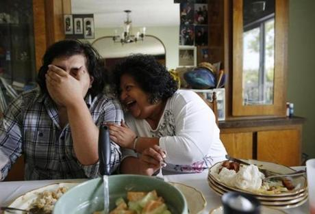 Cynthia de Victoria laughed with her son, Warren, 23, over breakfast at their home in Mattawa.