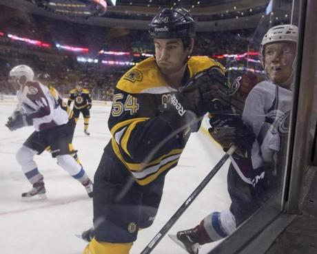 Adam McQuaid checked Avalanche Paul Stastny into the boards during first period action of the teams' faceoff on Thursday.