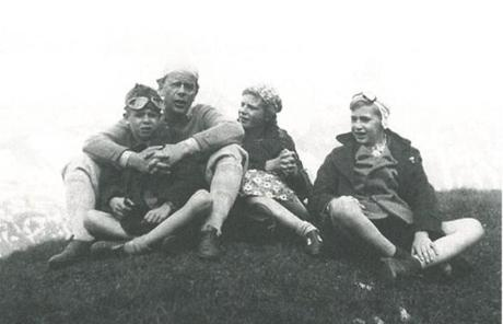 Christoph being held by his father, Hans, alongside his sister, Barbara, and brother, Klaus, in 1939.