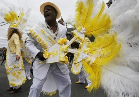 Ferdinand Snyder, of New Orleans, dances as he marches down Mass Ave with the Original Big 7 Social Aid & Pleasure Club during the Honk Fest Parade in Cambridge, Massachusetts October 13, 2013. (Jessica Rinaldi For The Boston Globe)