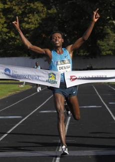Lelisa Desisa of Ethiopia also set a record in the men's race.