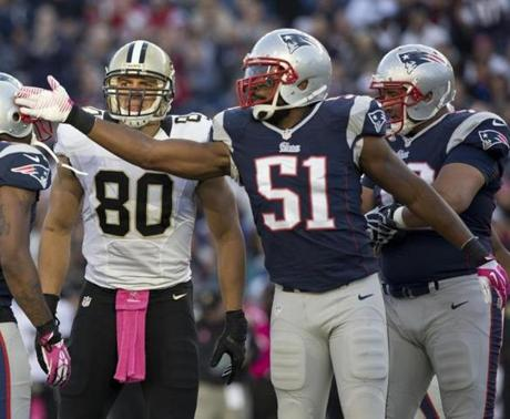 Jerod Mayo signaled first down in front of the Saints' Jimmy Graham during the first quarter.