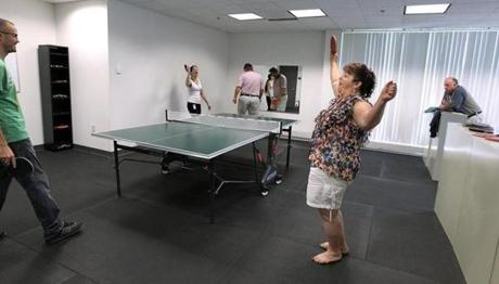 Customer service representative Angela Colon (right) and her partner beat CEO Ray Hendrickson and copywriter Pegge Bochynski in Christian Book Distributors' annual Ping-Pong tournament.