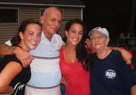 Michael Dutra in a 2011 family photo with daughters Shannon (left) and Michelle, plus his mother,  Evelyn Pemberton. His daughters say Dutra was a devoted family man who loved to cook and share his humor.