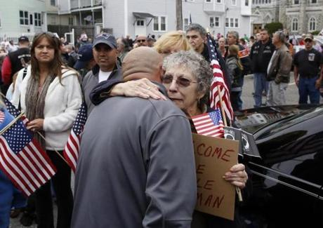 Jane Pepin Potter of Leominster, the niece of Private First Class Norman P. Dufresne, hugged family member Matthew Pepin, also of Leominster, after Dufresne's remains were brought home.