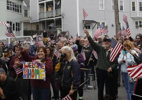 People lined the streets of Leominster Wednesday as a hearse carrying the remains of Private First Class Norman P. Dufresne passed by.