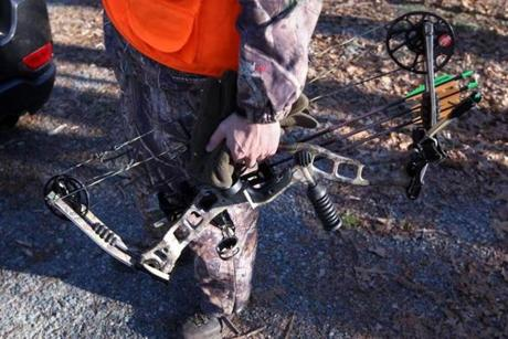 An area resident displayed the compound bow he used in one of Dover's previous efforts to reduce the local deer population; more than 60 bowhunters have been cleared to participate in the hunt.