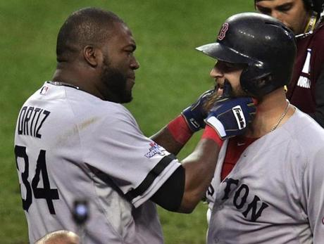David Ortiz and Mike Napoli celebrated with a pull of Napoli's playoff beard.