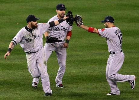 Jonny Gomes, Jacoby Ellsbury, and right fielder Shane Victorino celebrated the win.