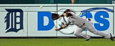 Jonny Gomes made a diving catch to rob Prince Fielder of a hit in the seventh inning.