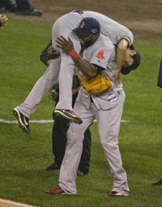 Sox David Ortiz carried Koji Uehara after he saved a 1-0 victory over Detroit.