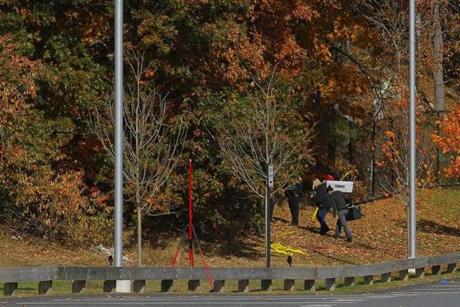 Investigators entered the woods behind the high school early Wednesday.
