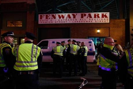 Police gathered outside Fenway Park as the Red Sox took on the Detroit Tigers last weekend. Officers are planning to use social media to warn fans to stay away from the Kenmore Square area should celebrations become too raucous.