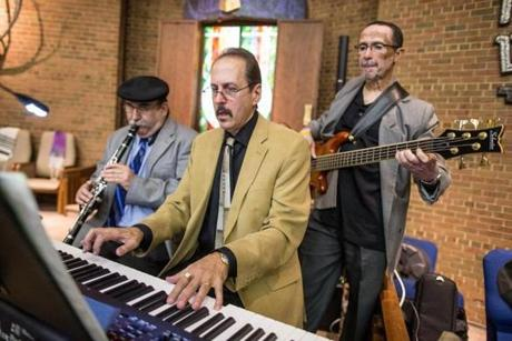 Band members L-R Steve Justin, Maestro Stan Schertzer, and Gerry Rollock perform with Cantor Jodi Schechtman during a Shabbat Unplugged service at Temple Beth Am in Framingham.