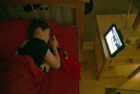 On the verge of sleep, 9-year-old Jamie Schumacher listened to Game 1 of the World Series on a tablet.