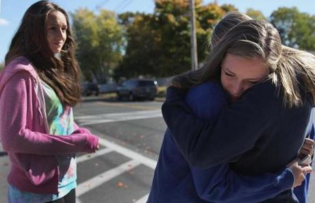 Katherine Kowalski (left) looked on as classmate Nicole White was comforted by a friend following a grief counseling session.