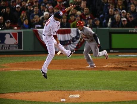 Red Sox pitcher John Lackey tried to move out of the way from Yadier Molina's line drive, which Dustin Pedroia caught, in the fourth inning.