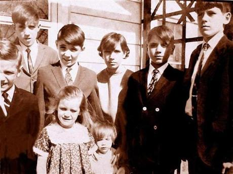"The only photo the family has of all eight children. The three oldest, Harry, Mike, and Susan, survived. Left to right, in the photo, are Billy, Mike, Kevin, Susan, Davey, and Harry. In the front are Lisa and Kathleen Claire, known as ""K.C."""