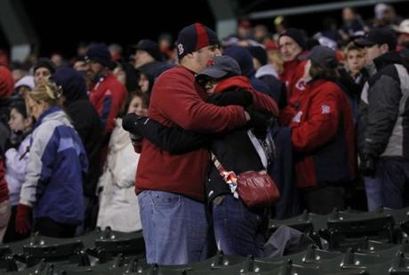 Fans embraced at the end of Game 2 after the Red Sox lost.