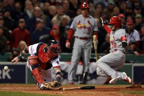 The throw from Jonny Gomes got by Jarrod Saltalamacchia as Pete Kozma scored on a seventh-inning sacrifice fly.