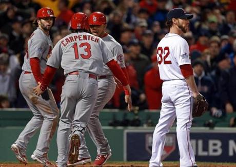 The Cardinals celebrated scoring on the Red Sox' errors in the seventh.
