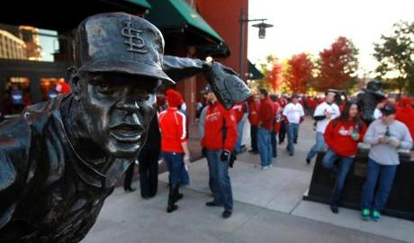 A statue of Cardinals great Bob Gibson greets fans at Busch Stadium.