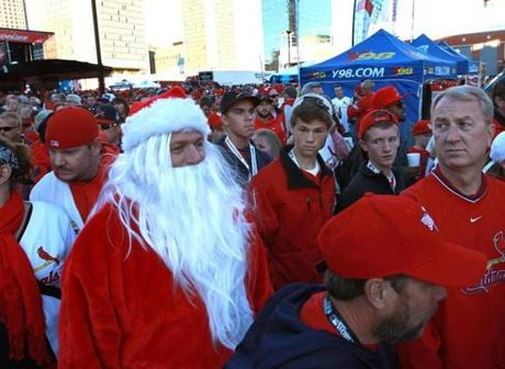 In a sea of Cardinals fans at Ballpark Village, Greg Dalton as Santa Claus stood out.