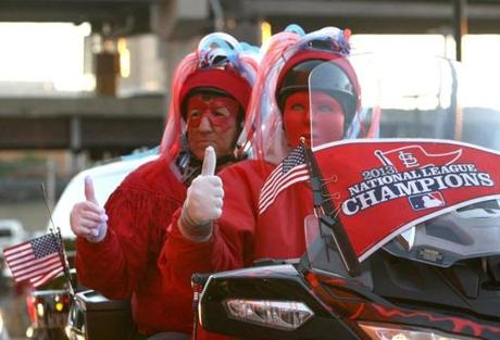 These two Cardinals fans waited on a motorcycle outside Busch Stadium.