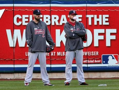 John Lackey and Jon Lester stood during pregame practice.