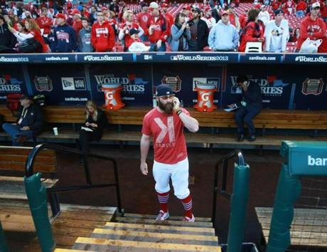 Injured Cardinals closer Jason Motte chatted on the phone before the game.
