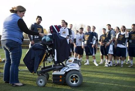 Courtney Davidopoulos talks with her son Matthew as the Merrimack men's lacrosse team waits to greet him before a recent scrimmage.