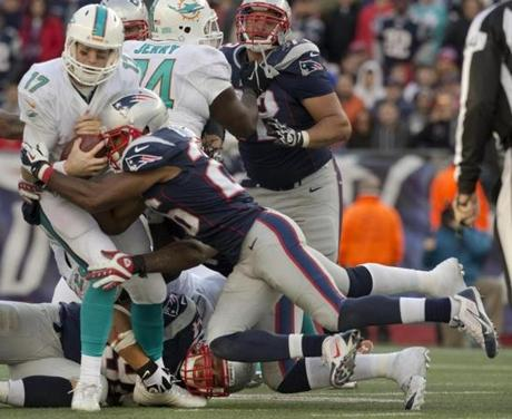 The Patriots sacked Tannehill in the fourth quarter.