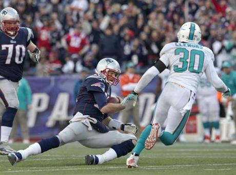 Brady slid in front of Chris Clemons after rushing for an 8-yard gain and a first down in the fourth quarter.