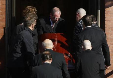 Pallbearers carried Ritzer's casket up the stairs of St. Augustine Church in Andover.