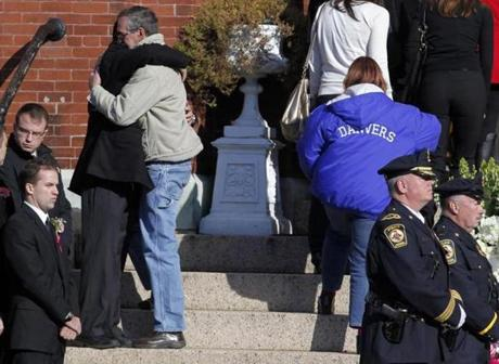 An estimated 1,000 mourners were in attendance, including 400 students from the Danvers school, officials said.d.