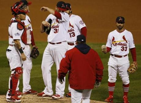 The Cardinals' pitching coach came to the mound to speak with starting pitcher Lance Lynn in the fifth inning.