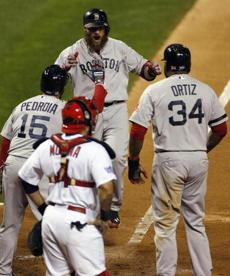 Gomes was greeted by Dustin Pedroia and David Ortiz at home plate.