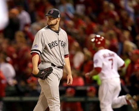 Jon Lester and Matt Holliday are seen after Holliday's home run in the fourth inning.