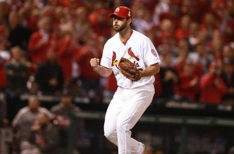 Cardinals starting pitcher Adam Wainwright pumped his fist after striking out Jacoby Ellsbury in the fifth inning.