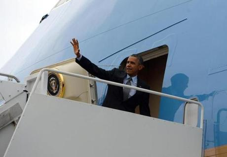 President Obama boarded Air Force One for a flight to Boston on Wednesday.