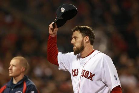 Red Sox John Lackey tipped his hat after being pulled from the game in the seventh inning.