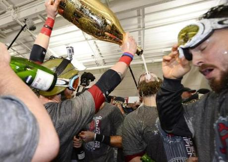 Gomes (left) poured champagne into the mouth of Mike Napoli.