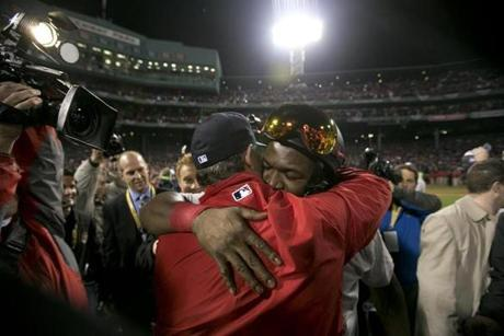 David Ortiz, who was named the World Series MVP, hugged manager John Farrell.